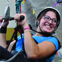 Katherine Torres who has a lower limb disability, uses the haul system (rope and pulley system) to scale the 41 foot RWC Climbing tower.