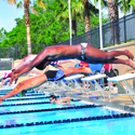 UCF Students compete in a swim meet at the UCF Lap Pool at the Recreation and Wellness Center. The Lap Pool has 9 lanes which are 25 yards long.