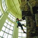 Female student scales the 41 foot Rock Climbing tower at the UCF Recreationa and Wellness Center