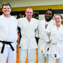 Four UCF Students show off their Judogi's during a Judo workout at the Recreation and Wellness Center.