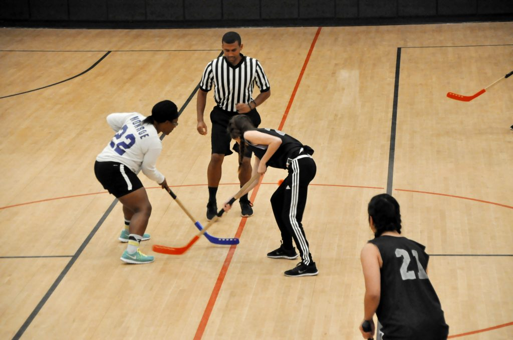 UCF Students playing floor hockey in the MAC Gym (courts 5&6)