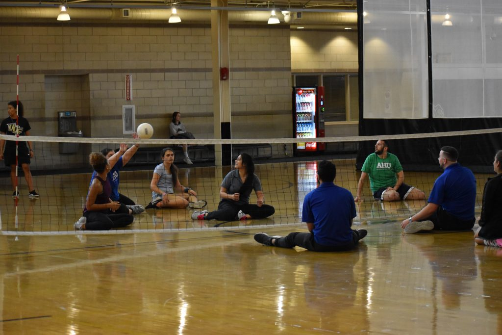 Students participating in Sitting Volleyball on Multipurpose Court 2