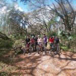 group of students on mountain bikes smiling
